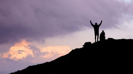 Victory silhouette, man on mountain